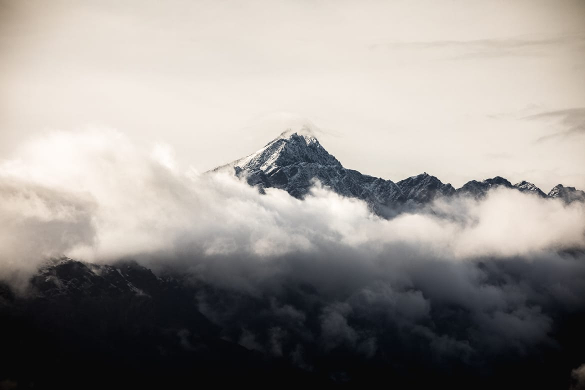 Mountains above Queenstown shrouded in clouds.