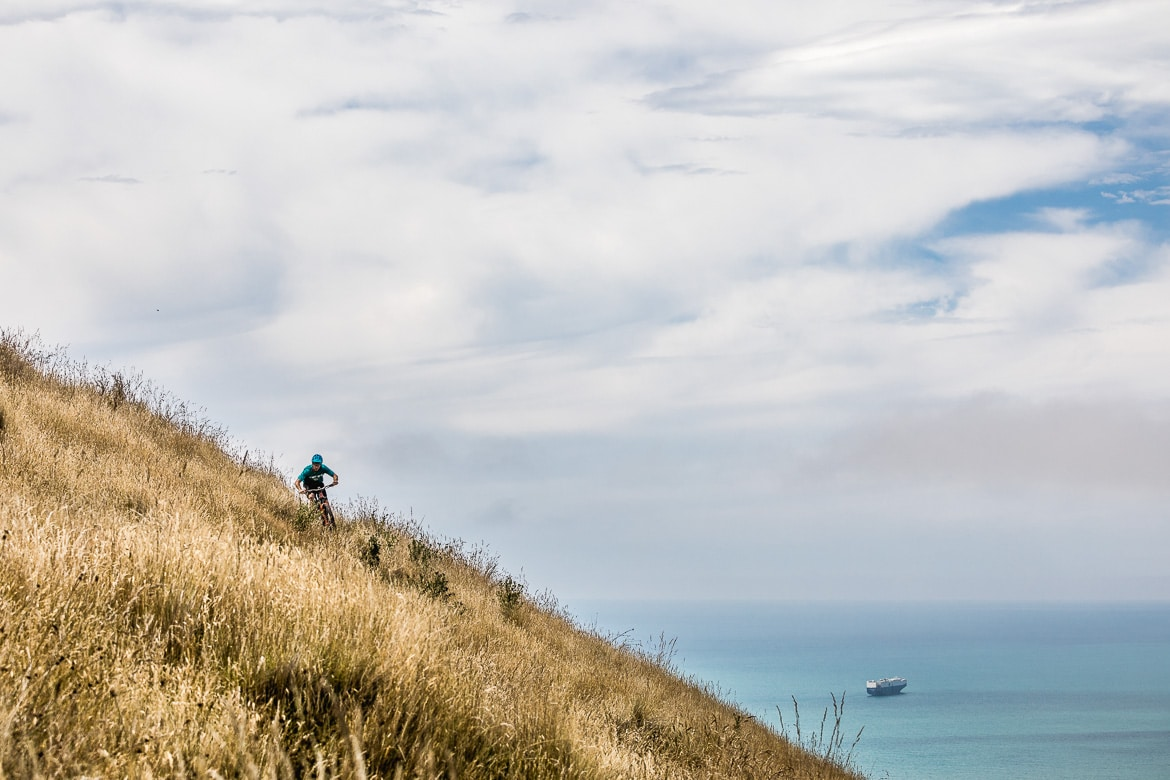 Yeti EWS racer Jubal Davis shredding in the Port Hills above Christchurch during the International Yeti Tribe New Zealand mountain bike tour.