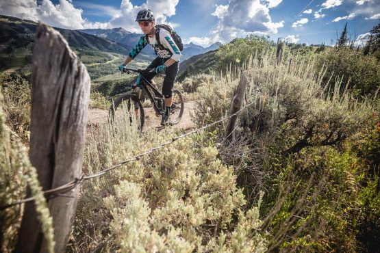 Riding the rim trail above Snowmass Village during our mountain bike tour Colorado.