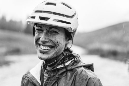 Black and white portrait of muddy mountain biker during our mountain bike tour Colorado.