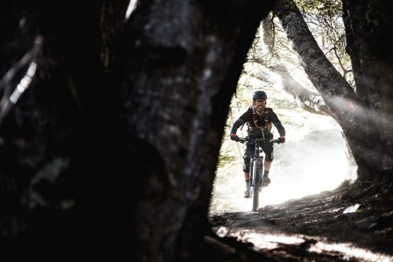 Mountain bike tour New Zealand - riding the roots trail in Queenstown, New Zealand.