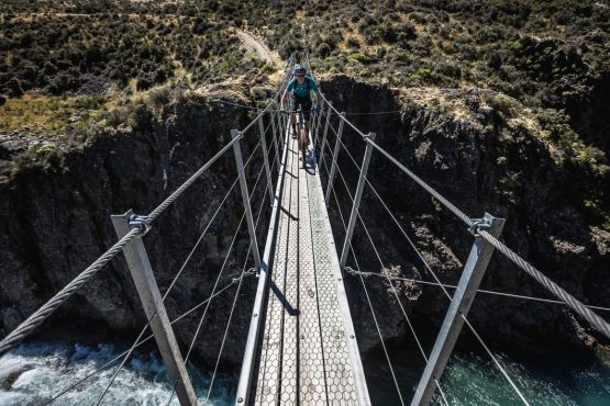 Crossing a bridge in St James during our Mountain bike tour New Zealand.