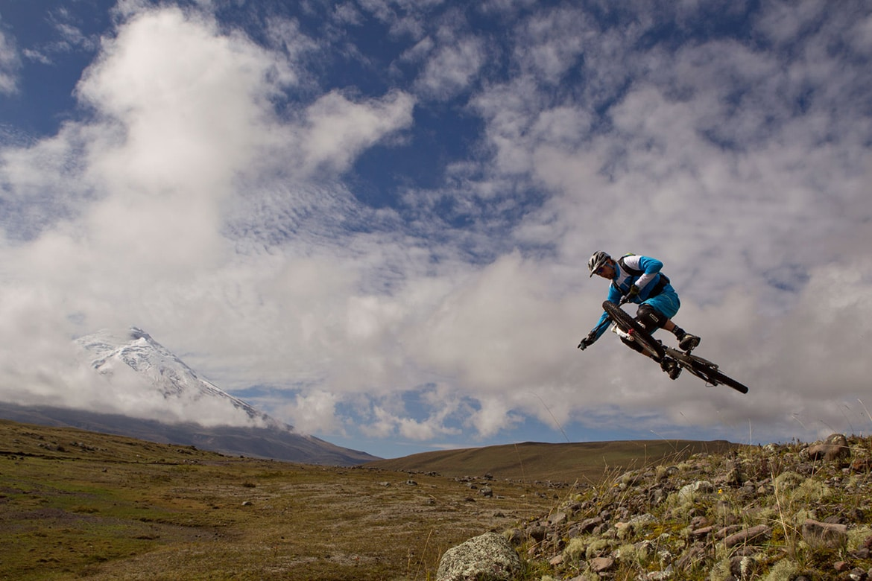 Top 10 mountain bike trails - Mountain bike riding Cotopaxi volcano during a mountain bike tour Ecuador.