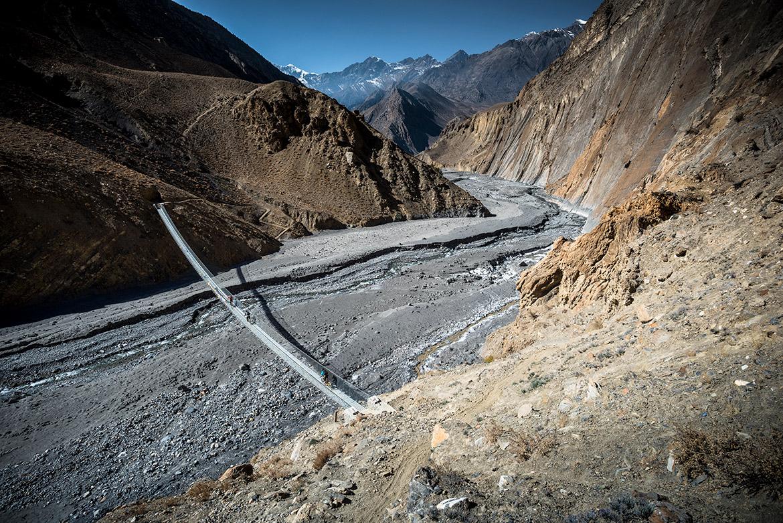 Top 10 mountain bike trails - Mountain bikers riding the Lupra Pass during our mountain bike tour Nepal.