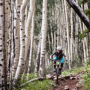 Nichole Baker riding through the Aspen Groves of 'Doctor Park' trail in Crested Butte, part of our mountain bike tour Colorado.