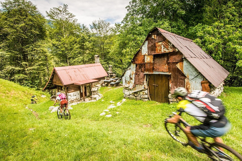 Top 10 mountain bike trails - Mountain bikers riding a mountain bike tour Slovenia.