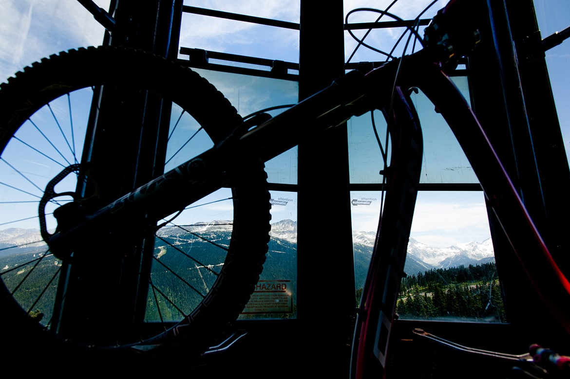 Top 10 mountain bike trails - Mountain bikers riding the Whistler bike park, top of the world, on our mountain bike tour British Colombia.