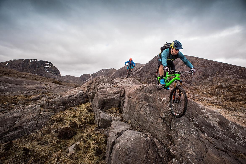 Top 10 mountain bike trails - Mountain bikers riding in Achnaschellach during a Scotland coast to coast mountain bike tour. One of our mountain biking adventures in Europe.