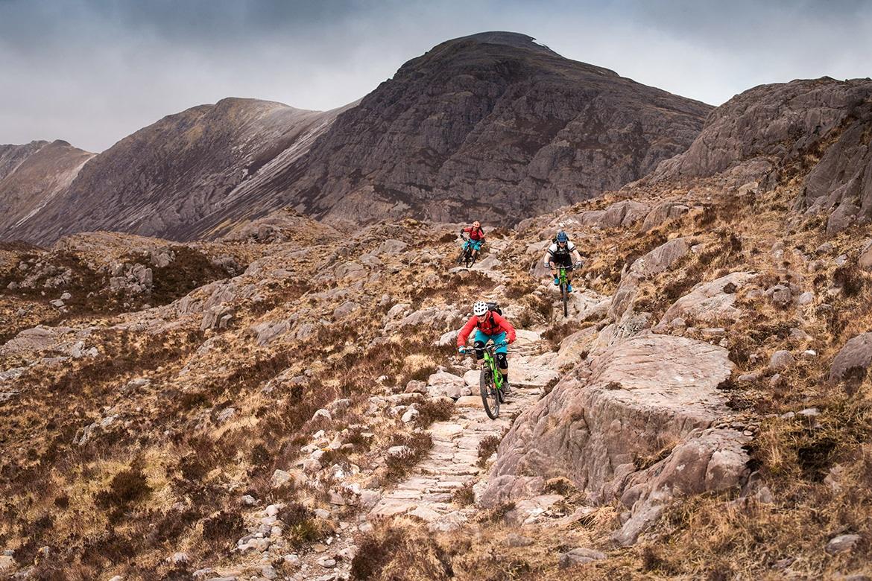 Top 10 mountain bike trails - Mountain bikers riding in Achnaschellach during a Scotland coast to coast mountain bike tour.
