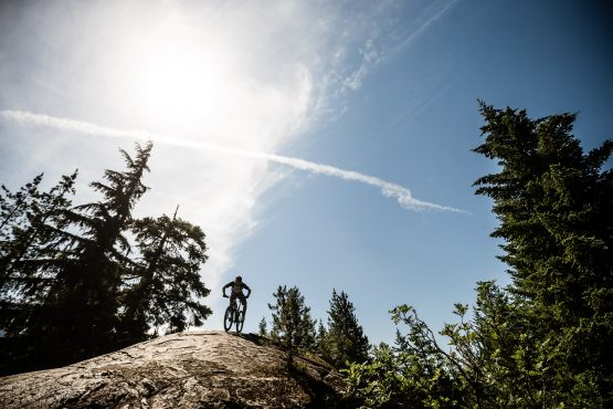Singletrack turns to wide open rock formation in BC, Canada