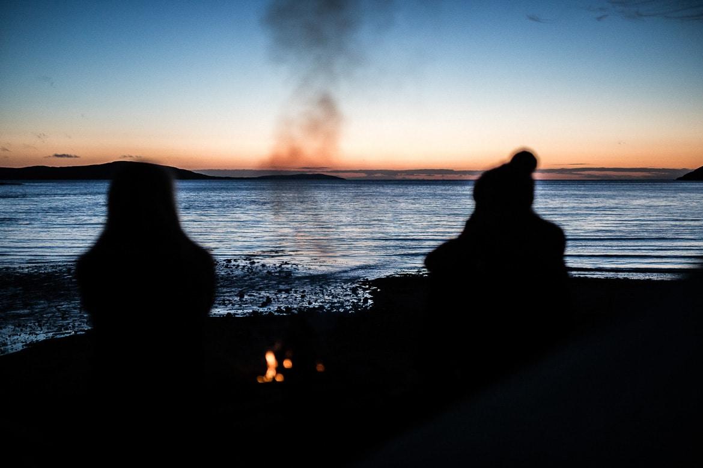 Sitting round the camp fire, bikerafting in Scotland