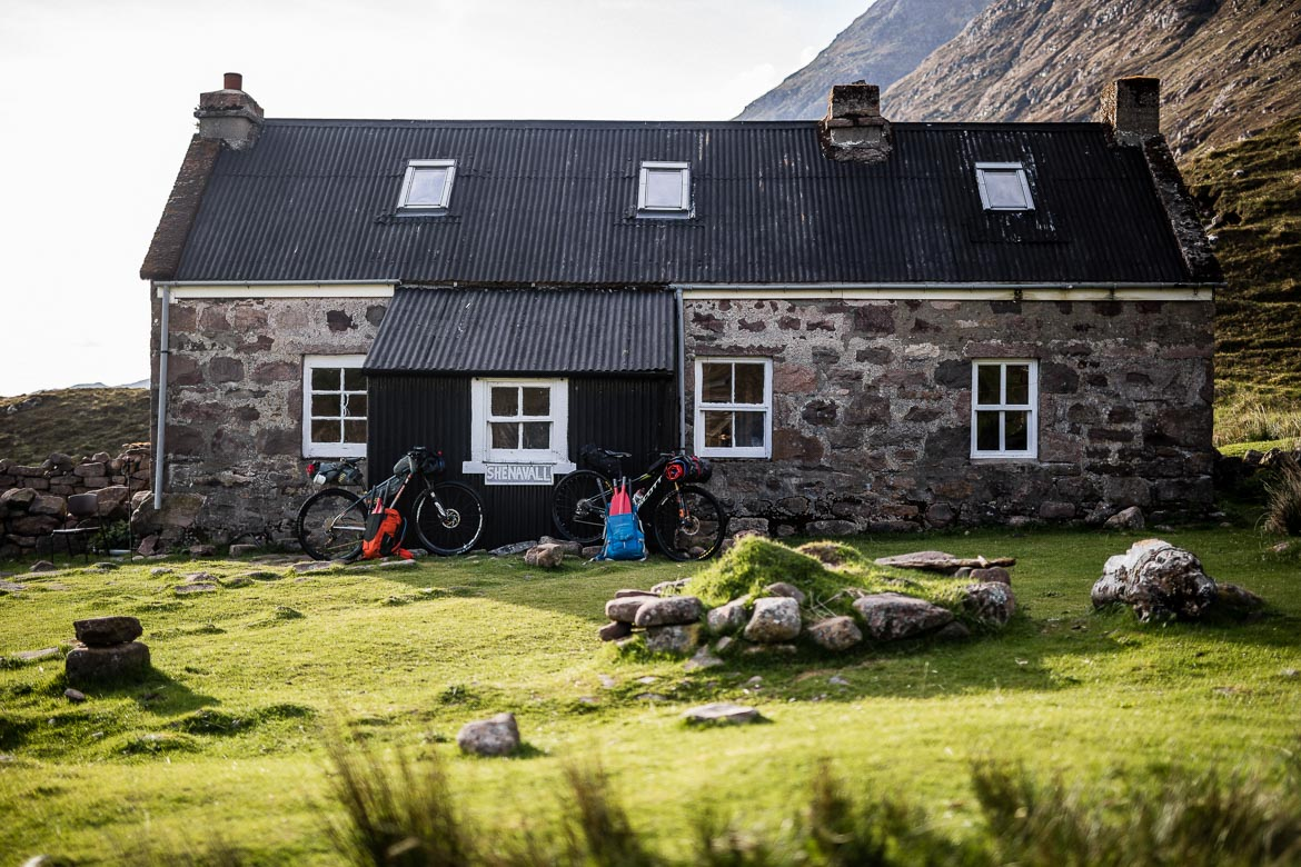 Bikerafting in Scotland, bikes outside Shenavall bothy. One of our Top 10 mountain bike photos.