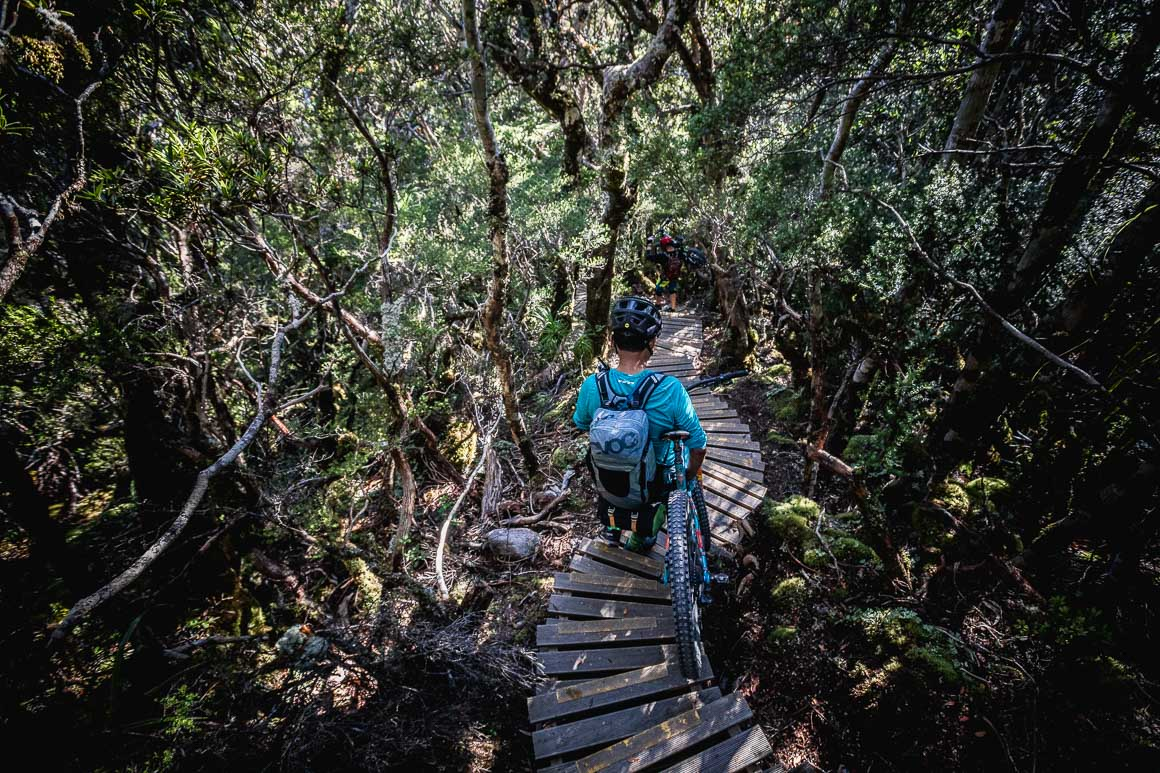 H+I guide Mandil taking to the stairs of the Old Ghost Road during our mountain bike tour New Zealand.