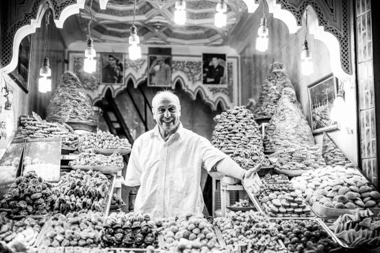 Market trader in Marrakech on H+I Adventures mountain bike tour Morocco