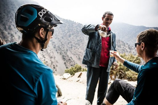 Tea pouring on the singletrack trail on this Mountain bike vacation Morocco