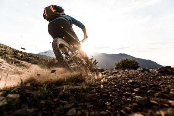 Eric Porter sliding around loose Moroccan singletrack corner on H+I Adventures Mountain bike tour Morocco