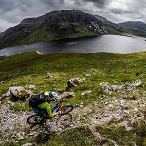 Riding a mountain bike tour Coast-to-coast in Scotland