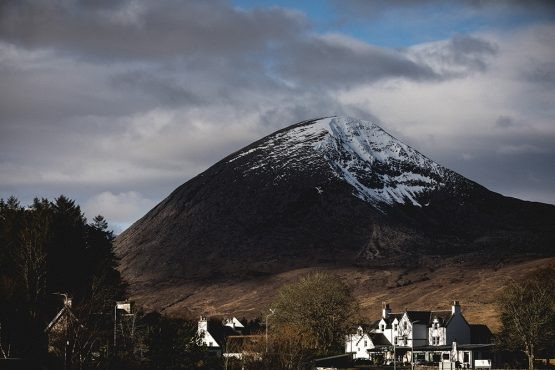 Beinn na Caillich towering over Broadford as seen on a mountain bike tour Torridon and Skye.
