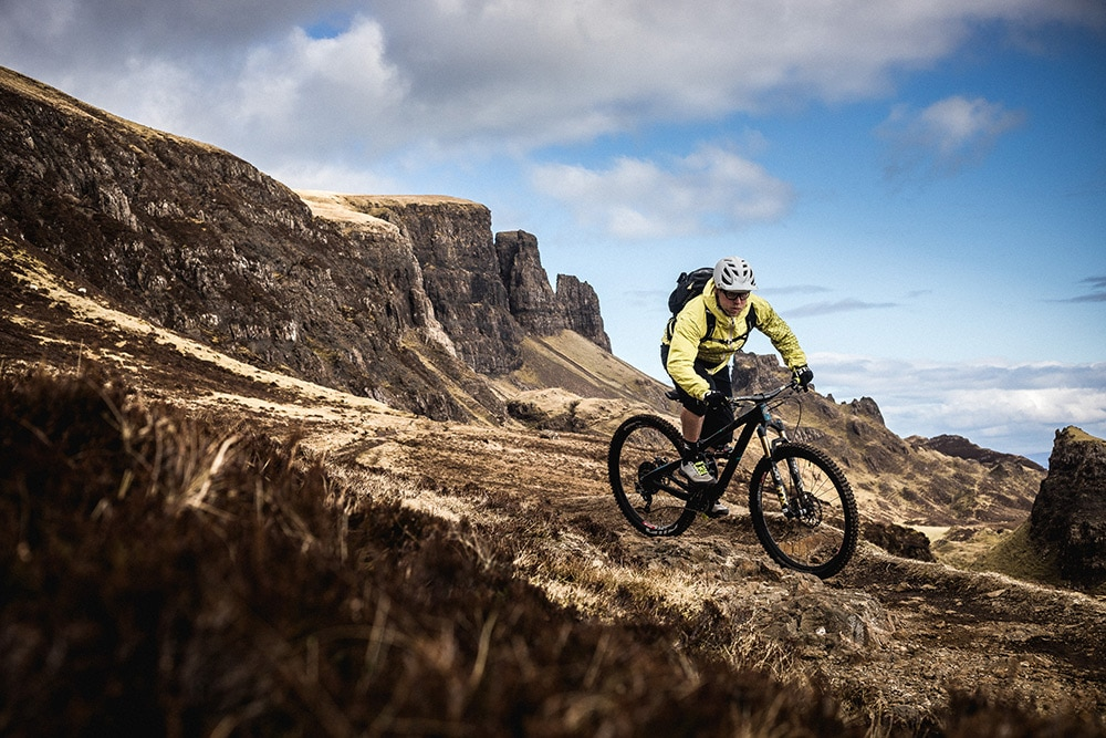 Riding technical rocks during a mountain bike tour Torridon and Skye.