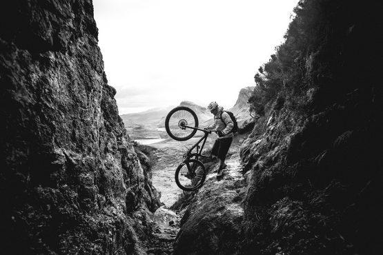 Negotiating a narrow passage during a mountain bike tour Torridon and Skye.