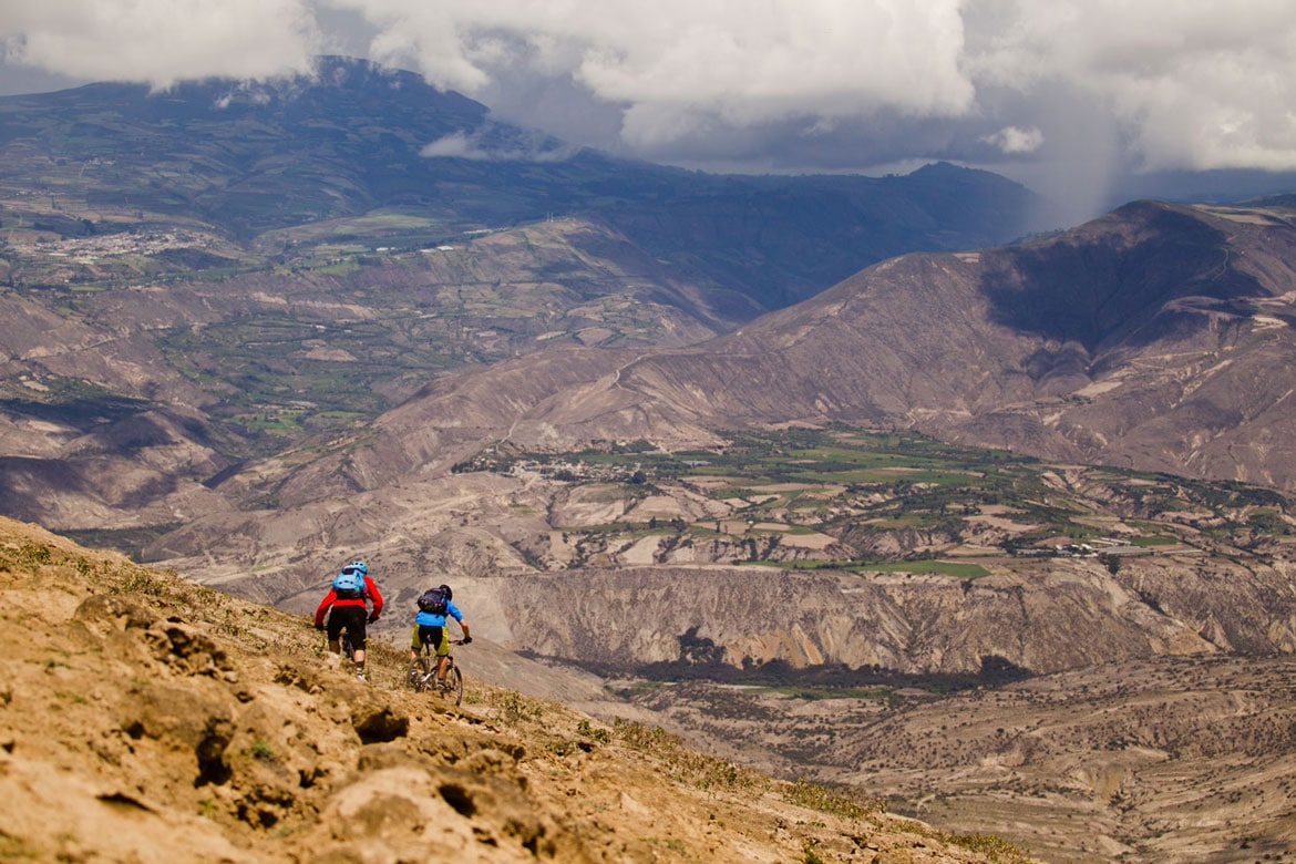 Riding a dry and dusty descent in Ecuador during a mountain bike adventures South America