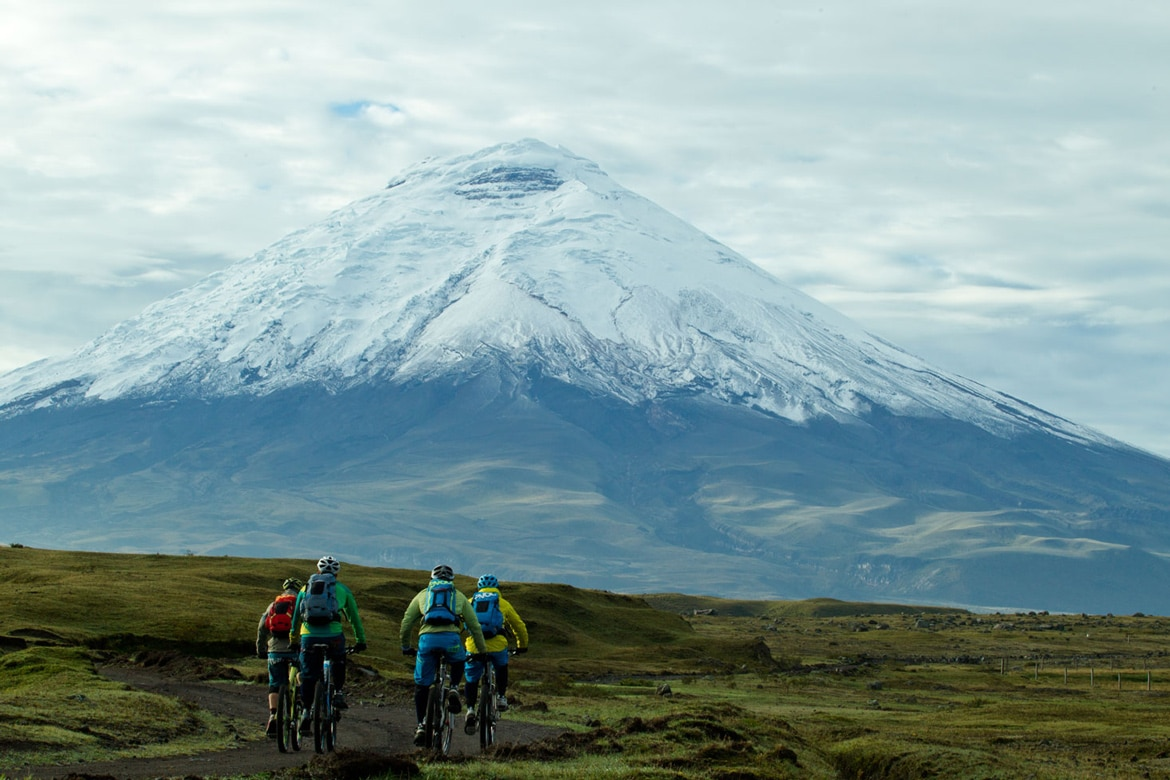 Riding towards a volcano in Ecuador during our mountain bike adventures South America