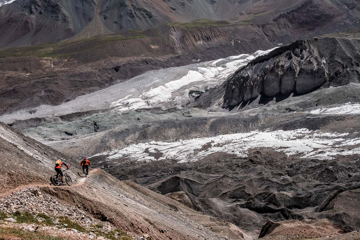 Rene Wildhaber in front of Tom Oehler on a descent whilst Mountain biking in Kyrgyzstan