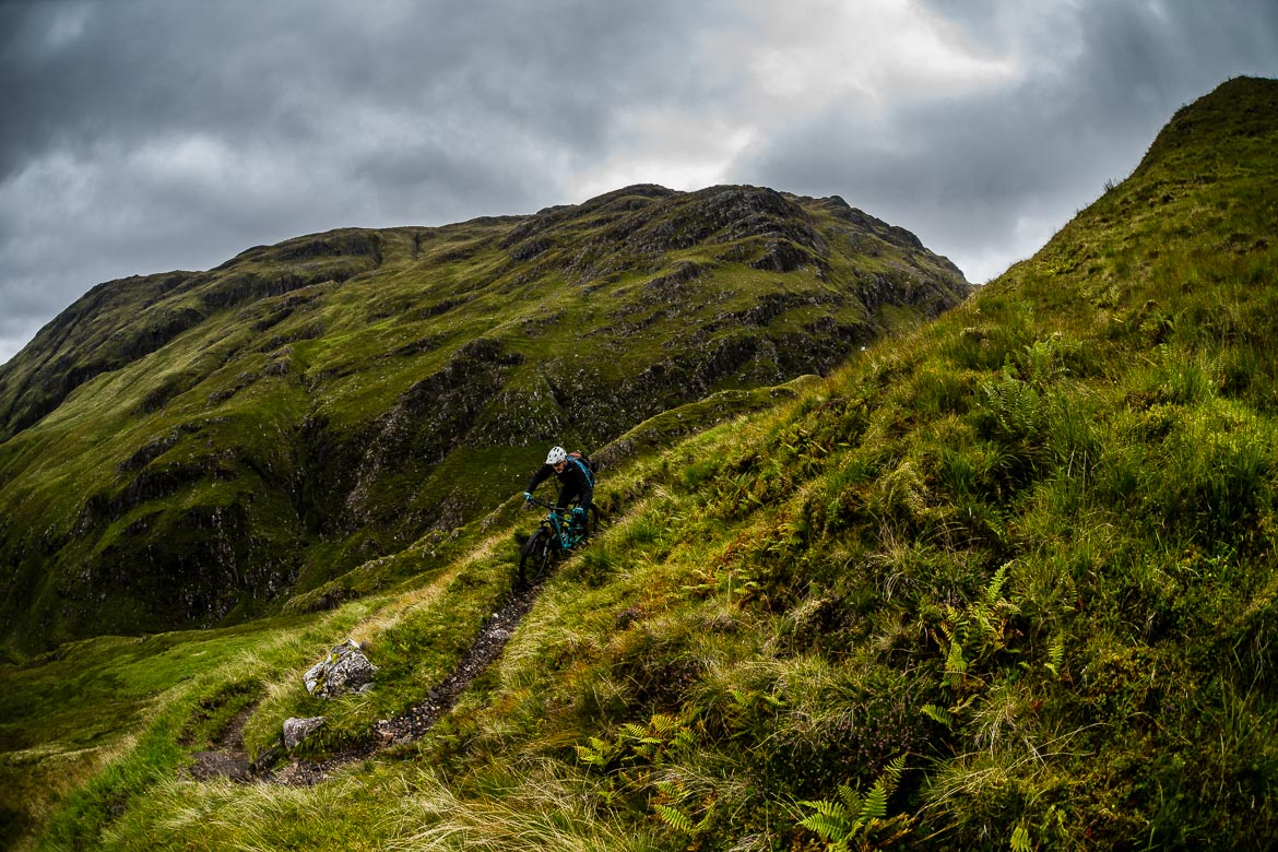 Mountain bikers riding the Morvich descent on the Yeti Tribe Scotland