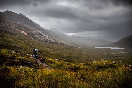 Riding in the Scottish rain during a Mountain bike tour Torridon and Skye