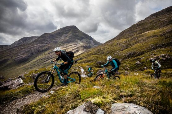 Climbing away from the Coulags bothy during a Mountain bike tour Torridon and Skye