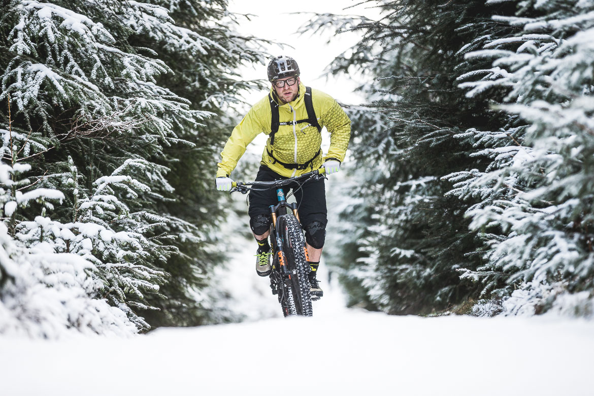 Riding in snowy forests with local Aviemore mountain bike guide Chris Gibbs