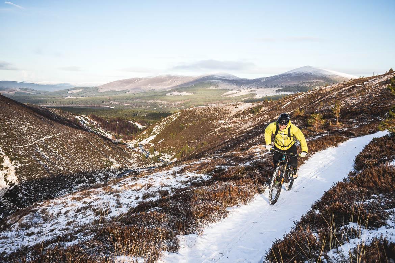 Local Aviemore mountain bike guide Chris Gibbs climbing through the hills of the Cairngorms.