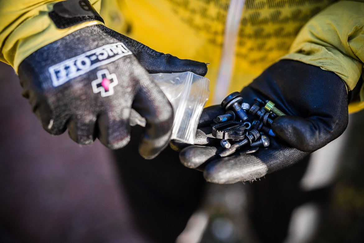 Best mountain bike trailside fixes include carrying a bag of assorted bolts.