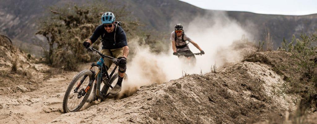 Kicking up dust on our mountain bike tour Ecuador