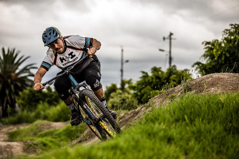 Local mountain bike guide Ecuador José Jijon riding a pump track berm.