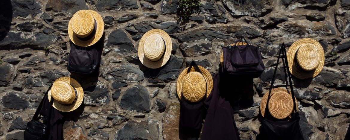 EWS Travel Madeira - straw hats on the wall