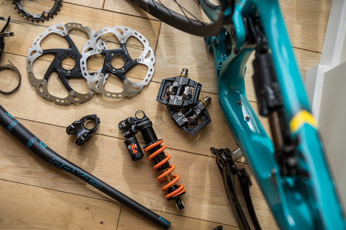 An exploded diagram of Shimano, FOX, and RaceFace parts for a Yeti SB150 dream build