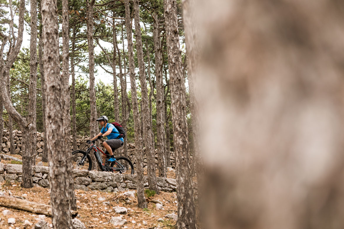 Cranking up a climb in Baška on a E-MTB Tour Croatia