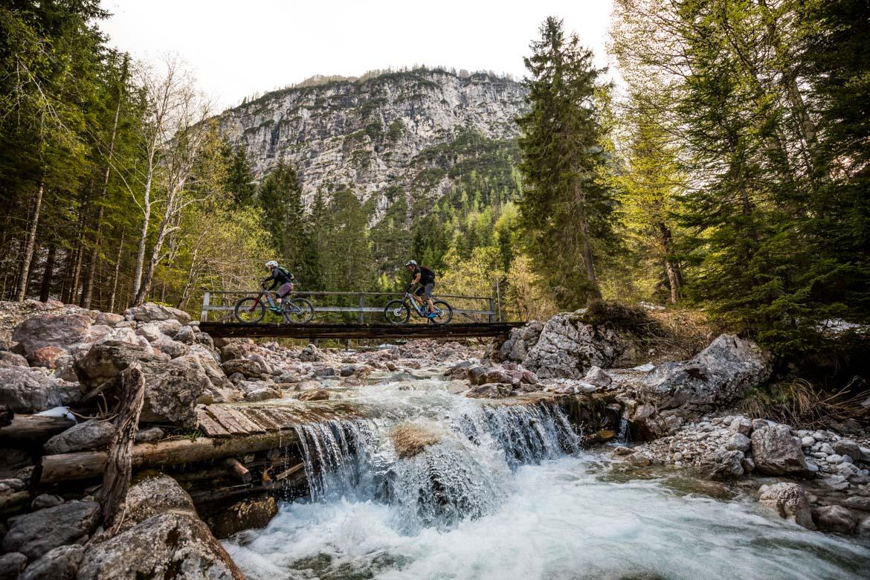 Passing over a river on a E-MTB tour of Slovenia