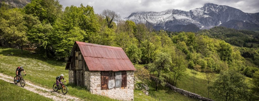 Passing rustics farm huts on a E-MTB tour of Slovenia