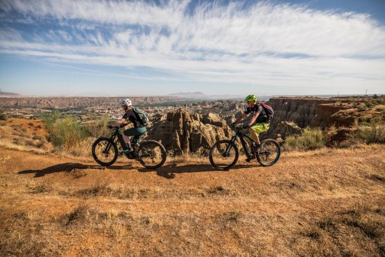 E-MTB tour of Spain cresting the canyon
