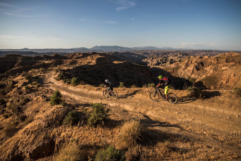 Riding at dusk on a E-MTB Tour Spain
