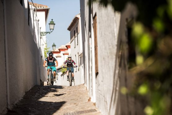 Riding cobbled streets on our E-MTB tour of Spain