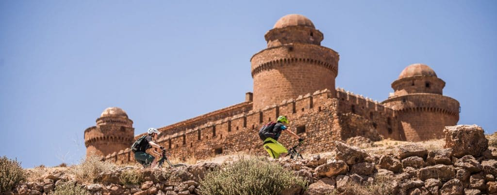 Climbing to an ancient palace on our E-MTB Tour Spain