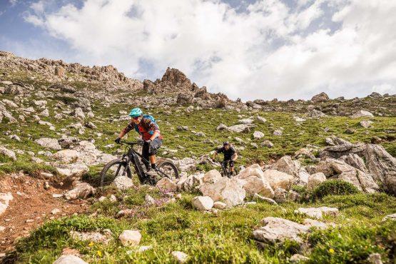 Blasting through the rocks on a E-MTB Tour In Switzerland