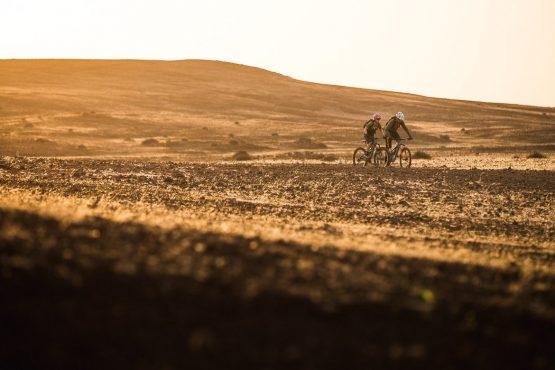 Heading back to camp as sun sets during a mountain bike safari tour Namibia