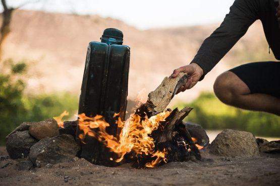 Keeping the fire stocked up on a mountain bike safari tour Namibia