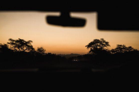 Heading home at sunset on a mountain bike safari tour Namibia