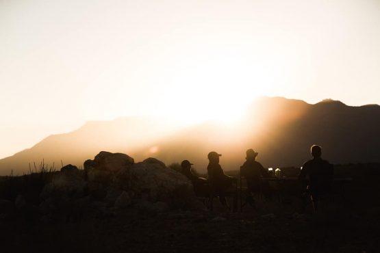 Enjoying the last sunset on a mountain bike safari tour Namibia