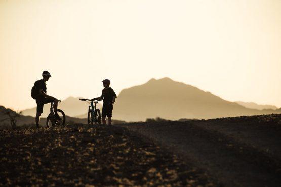 Taking in the sunset on a mountain bike safari tour Namibia